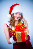 Beautiful woman in a red dress and hat of Santa Stock Photos