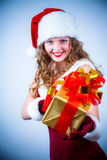 Beautiful woman in a red dress and hat of Santa Stock Photography