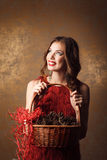 beautiful woman in red dress holding basket Royalty Free Stock Image