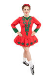 Beautiful woman in red dress for Irish dance isolated. On white Stock Images