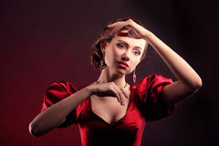 Beautiful woman in red dress like a doll Royalty Free Stock Photos