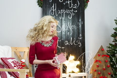 Beautiful woman in a red dress with many gift boxes Stock Image