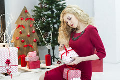 Beautiful woman in a red dress with many gift boxes Royalty Free Stock Photo