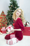 Beautiful woman in a red dress with many gift boxes Royalty Free Stock Photography