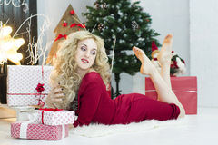 Beautiful woman in a red dress with many gift boxes Royalty Free Stock Photos