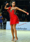 Beautiful woman in red dress perform during dancesport competition Royalty Free Stock Images