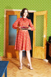 Beautiful woman in red dress with pie Stock Photography