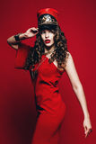 Beautiful woman in red dress and red hat Royalty Free Stock Image