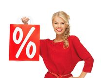 Beautiful woman in red dress with shopping bag Royalty Free Stock Photo