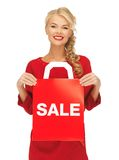 Beautiful woman in red dress with shopping bag Stock Photos