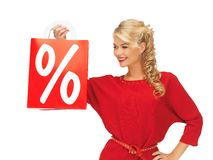 Beautiful woman in red dress with shopping bag Royalty Free Stock Photos