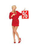 Beautiful woman in red dress with shopping bag Stock Images