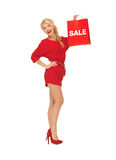 Beautiful woman in red dress with shopping bag Stock Photo