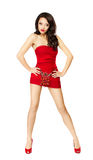 Beautiful woman in red dress standing provocative stock photo