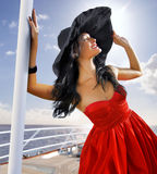 Beautiful woman in red dress on the yacht royalty free stock images