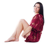 Beautiful woman in red dressing gown Stock Photos