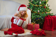 Beautiful woman in red enjoying christmas present Royalty Free Stock Photo