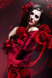 Beautiful woman in red fabric Royalty Free Stock Image