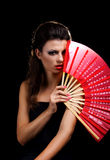 Beautiful woman with red fan Stock Photos