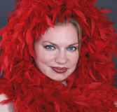 A beautiful woman in the red feathers Royalty Free Stock Photography