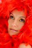Beautiful woman with red feathers Stock Photo