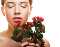Beautiful woman with red flowers Royalty Free Stock Image