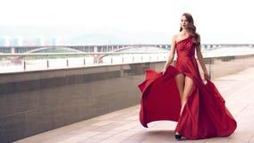 Beautiful woman in red fluttering dress.