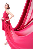 Beautiful woman in red flying dress Stock Photography