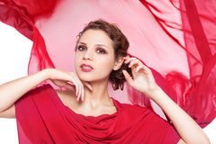 Beautiful woman in red flying dress Royalty Free Stock Image