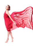 Beautiful woman in red flying dress Stock Photos