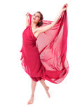 Beautiful woman in red flying dress Royalty Free Stock Photography