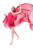Beautiful woman in red flying dress Stock Image