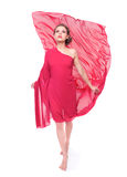 Beautiful woman in red flying dress Stock Photo