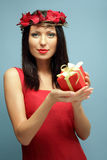 Beautiful woman with red gift Royalty Free Stock Image