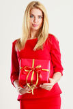 Beautiful woman with red gift. Stock Image