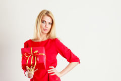 Beautiful woman with red gift. Royalty Free Stock Photo