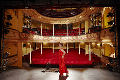 Beautiful Woman In Red Gown On Stage Stock Image
