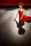 Beautiful Woman In Red Gown On Stage Royalty Free Stock Image