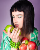 Beautiful woman with red and green  apple Royalty Free Stock Image