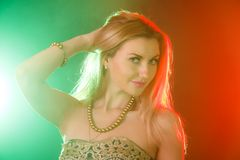 Beautiful woman between red and green bright lights Stock Image