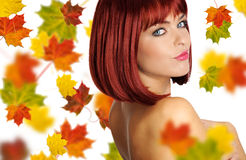 Beautiful woman with red hair. Beautiful young woman with red hair amd maple leaves royalty free stock photos