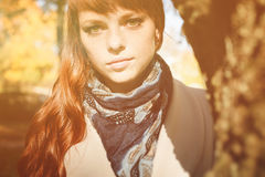 Beautiful freckle woman with red hair in autumn park. Beautiful freckle woman with red long hair in autumn park Stock Image