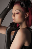 Beautiful woman with red hair and black paint on hands Royalty Free Stock Photos