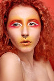 Beautiful Woman with Red Hair and bright makeup Stock Photography