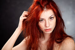 Beautiful woman with red hair and freckles Stock Image