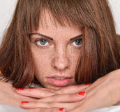 Beautiful woman with red hair and freckles in the bed Stock Images