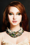 Beautiful Woman with Red Hair and Makeup Stock Image