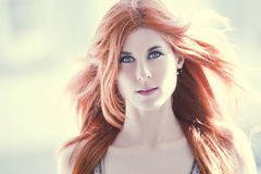 Beautiful woman with red hair stock image