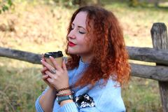 Portrait of a beautiful woman with red hair and closed eyes royalty free stock photography