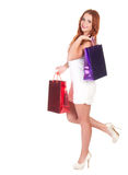 Beautiful woman with red hairs holding shopping bags Stock Photos